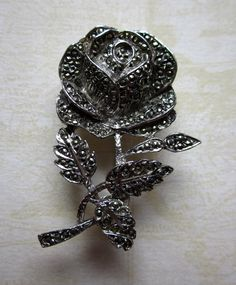 Pretty Rose Marcasite Brooch, £5.50 by JessamyElvira:  This charming, sparkly, vintage marcasite rose brooch is lovely to wear now that spring is here and the flowers are starting to come out. But this flower won\\\'t fade like the others, it will carry on into summer.   This brooch is fairly heavy, so it would be just right for your new spring jacket or coat, giving a touch of elegance and charm, but would also be perfect for a summer cardigan, adding a layer of warmth.   This brooch is…