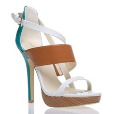 ZIVA: This summery sandal is still a cosmopolitan find thanks to a sultry mix of textures and straps.    This the TEAL version of this shoe, love it more than the brown.