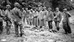 Prisonniers allemands à Saint-Martin-de-Vareville, sous la garde de paras du 502 PIR de la 101th Airborne Division.