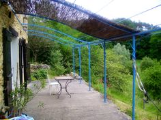 Iron Pergola With Canopy | Here the client has installed shade on this blue painted trellis ...
