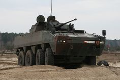 The Rosomak armored personnel carrier is a Polish license-produced version of the Finnish Patria AMV. This APC is locally built in Poland. This armored vehicle proved itself well during international deployments. Army Vehicles, Armored Vehicles, Patria Amv, Armoured Personnel Carrier, Military Pins, Armored Fighting Vehicle, Tactical Gear, Wheels, Tanks