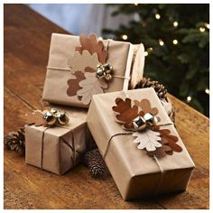 Love the natural look with brown paper and gold bells ♥