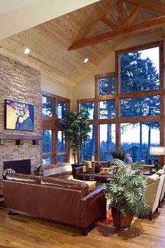 Architectural Designs Rustic Craftsman House Plan 69407AM with dramatic vaulted great room