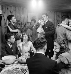 "Teenagers at a party in 1947 in Tulsa, Oklahoma; LIFE reported that they ""munch doughnuts and sip cokes whenever they are not dancing with serious faces to sentimental music."""