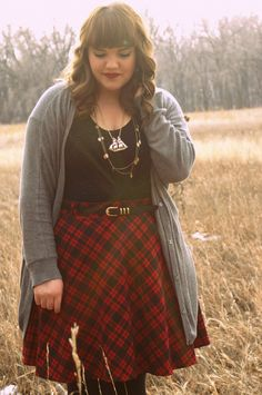boundlessadventure:  Plaid and Christmas Skirt and Cardi: Torrid Tights and shirt: Target Lipstick: MAC (Russian Red) Necklace: Forever 21
