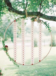 Mount your escort cards in midair with this design that reminds us of a hula hoop. Accented with flowers, this is a modern twist on the classic escort card ...