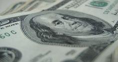 São Paulo - O dólar à vista abriu em queda ante o real nesta sexta-feira, 20, feriado de Consciência...