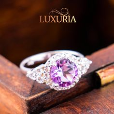 The MÉTHYSTOS ring by Luxuria is an elegant, classic and timeless purple amethyst centre stone ring of overall 11mm top width. Crafted from the finest quality rhodium plated 925 hallmark sterling silver the ring features a vibrant natural amethyst stone of approx. 1.7 carat t.w., set in silver claws and encircled by sparkling white cubic zirconia's which are also shoulder set. Quite simply a gorgeous choice for any occasion.  http://www.stylabs.co.nz/shop/product/Methystos/8316.aspx