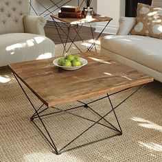 Angled Base Coffee Table / These angles might be too much, but I really like that it's a wood-top table that doesn't feel heavy. I think the other option is glass top with wood base.