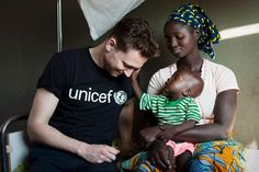 Tom with Alima and her one-year-old son, who's receiving treatment at a UNICEF-supported hospital for malaria and malnutrition. © UNICEF/Harry Borden/2013