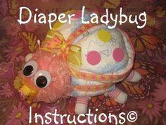 Learn to make a Ladybug from diapers, socks, etc. diaper cake keepsake. GR8 baby shower gift via Etsy