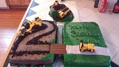 Construction cake. Chocolate cake with chocolate buttercream frosting on the left. Oreos for the dirt and used a grass tip to fill in the corners a bit. The right is white cake with buttercream. The road and river in between is marshmallow fondant and a kit Kat bridge. The one in back is a 6 inch smash cake. This one was really fun.
