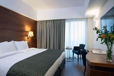 Standard room of Samaria Hotel with a street-view balcony. Hardwood Floors, Flooring, Contemporary Style, Curtains, Bed, Crete, Balcony, Furniture, Street View