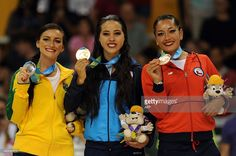 July 12 - Roller Sports - Figure Skating - Women's Free Program.  Gold medalist Giselle Soler of Argentina (C), Silver winner Talitha Haas of Brazil (L), nd bronze winner Marisol Villarroel of Chile (R) celebrate their medals in the Roller Sport-Figure Skating Final competition at the 2015 Pan American Games in Toronto, Canada, on July 12, 2015. AFP PHOTO/HECTOR RETAMAL