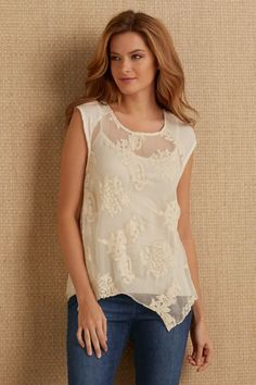 You can feel the romance in the air when wearing our Eammon Embroidered Tunic! It features dimensional embroidered medallions and cap sleeves that instantly dress up your favorite pair of jeans!
