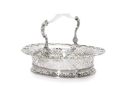 A George II silver basket, John Jacob, London, 1738 oval, the spreading foot and sides pierced with scrolls, diaperwork and other motifs below an applied border of shells, the swing handle engraved with a Scottish crest and motto  Sold for 11,875.00 GBP
