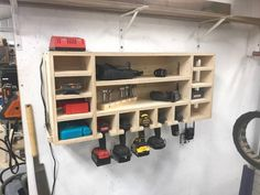 Drill Storage Charging Station is part of Diy garage storage - 4 tall x 10 deepUnit does not include drills, bits, drivers, or other accessories shown in the pictures They are for demonstration purposes only Power Tool Storage, Garage Tool Storage, Garage Tools, Diy Storage, Garage Workbench, Garage Shop, Workbench Ideas, Diy Garage Storage Shelves, Power Tools