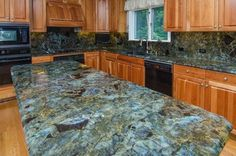 Lemurian Blue Labradorite Kitchen with Full Backsplash traditional kitchen Gemstone Countertops, Blue Granite Countertops, Granite Slab, Granite Kitchen, Kitchen Countertops, Kitchen Islands, Condo Kitchen, New Kitchen, Kitchen Ideas