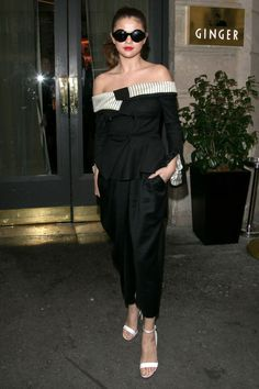 Gomez proved that black and white is always right, sporting a Monse off-the-shoulder jumpsuit, big sunnies and red lips.