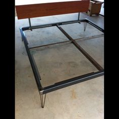 King size bed frame for sale, $500. Welded steel tube with hair-pin legs and a rosewood headboard. Comes with the ply sheets to place your b...