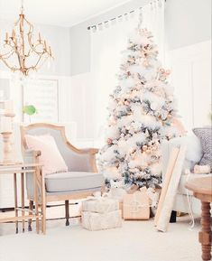Stunning flocked Christmas tree design inspiration.  Love the use of white feather boa to feel like snow.