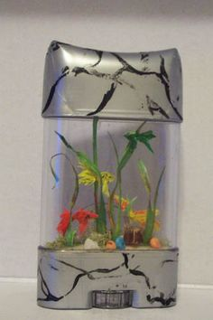 Toy Aquarium made out of a deodorant stick. Theres no instructions but you have to agree its amazing how she made a deodorant stick into an aquarium for a dolls scene.