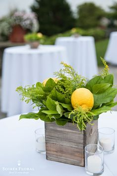 Lemon and Solidago filled wooden boxes for the cocktail arrangements. | The Westmoor Celebrates Cote d'Azur Style on Nantucket for their Annual Member's Party | #nantucket #soireefloral
