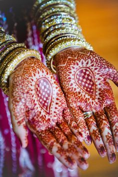 gorgeous henna with layer upon layer of beautiful bangles Photography By / , Event Planning By / , Floral Design By /  #Beautiful jewelry!!!#You would like...#