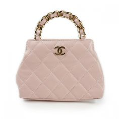 This is an authentic CHANEL Lambskin Quilted Mini Evening Bag Pink.   This chic evening bag is beautifully crafted of soft diamond quilted powder pink lambskin leather.