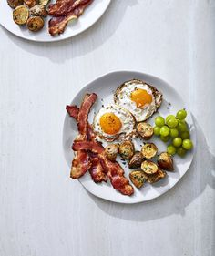 Crispy Fried Eggs With Rosemary Potatoes and Bacon | Get the recipe for Crispy Fried Eggs With Rosemary Potatoes and Bacon.