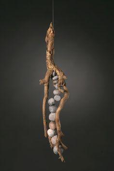 Becky Holtzman, Embrace, 2008, found wood, papier mache, acrylic, monofilament.