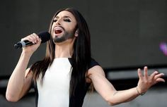 Austrian singer and Eurovision Song Contest winner Conchita Wurst performs on stage  in front of the federal chancellery in Vienna, Austria on Sunday, May 18, 2014.  Bearded drag queen Conchita Wurst had made a triumphant return to Austria last week  after winning the Eurovision Song Contest in Copenhagen in what the country's president called a victory for tolerance in Europe. (AP Photo/Hans Punz)