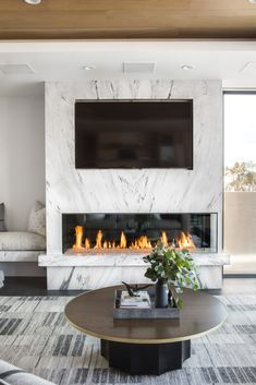 All marble fireplace surround with inset TV. So chic and sophisticated! Design by Chad Mellon Minimalist Fireplace, Fireplace Design, Fireplace Mantels, Hearth, Corner Fireplace Layout, Home, Stove, Fireplace Shelves, Fireplace Mantel