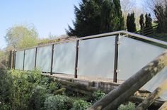 Modern design balustrade system with privacy screens. Supplied and installed in Gloucestershire area.