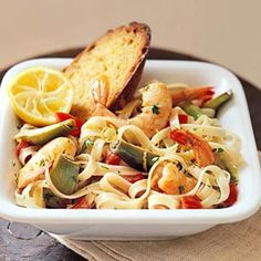 Fettuccine with Baby Artichokes and Shrimp. When fresh baby artichokes aren't available you can use frozen artichoke hearts for this delicious pasta. Fish Recipes, Seafood Recipes, Pasta Recipes, Great Recipes, Cooking Recipes, Favorite Recipes, Spaghetti Recipes, Recipies, What's Cooking