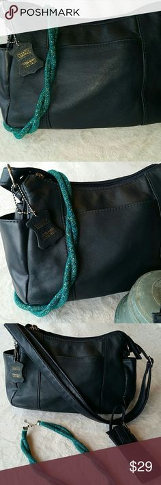 Cabin Creek Purse 100 % Lambskin Leathet Navy Cabin Purse. Two outside side pockets, one outside front pocket, dual top zippered pockets with interior snap section. Cabin Creek Bags Shoulder Bags