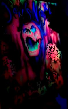 airbrush blacklight painting of a neon skull pile. This is an a scene from the devils night event in Chicago night club by chicago graffiti artist diego Diablo. #airbrush #chicagoartist