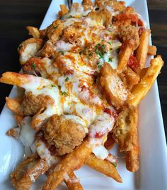 "Junk Food food-porn-diary: ""Garlic parmesan fries topped with boneless chicken wings, marinara sauce and melted mozzarella cheese. Food To Go, I Love Food, Good Food, Food And Drink, Yummy Food, Tasty, Junk Food, Garlic Parmesan Fries, Food Porn"