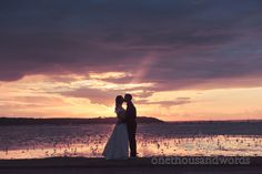 Wedding couple kiss at sunset on beach. Photography by one thousand words wedding photographers