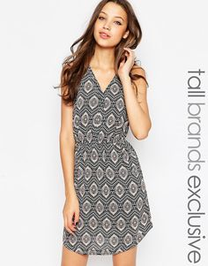 Buy it now. New Look Tall Printed Smock Dress With Eyelets - Multi. Casual dress by New Look Tall, Lined woven fabric, V-neckline, Concealed press stud placket, Embellished eyelet trim, Stretch waistband, Regular fit - true to size, Machine wash, 100% Polyester, Our model wears a UK 8/EU 36/US 4 and is 180cm/5'11� tall, Excusive to ASOS. ABOUT NEW LOOK TALL Offering perfectly proportioned, fast off the catwalk styles, New Look Tall joins the ASOS round up of great British high street…