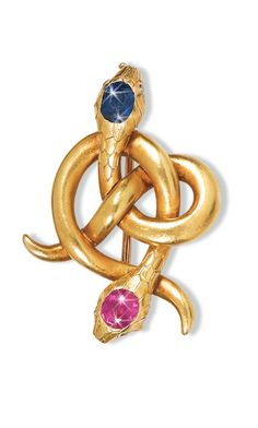 A FABERGÉ JEWELLED GOLD BROOCH, MOSCOW, 1899-1908 modelled as two intertwined snakes, the heads set with a faceted sapphire and ruby, struck KF in Cyrillic, 56 standard, scratched inventory number 22078 width 3.5cm, 1 5/8 in.