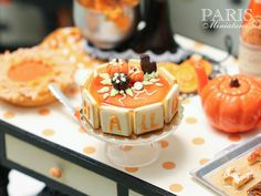 Miniature Food -    A beautiful cake for Halloween decorated with candy and chocolate pumpkins and a tiny chocolate cat. The sides of the cake