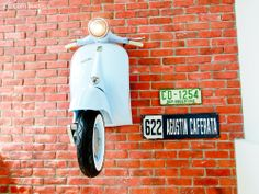Z L Construction (Singapore) // Craftstone feature brick wall with mounted Vespa