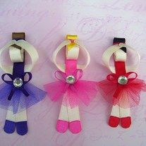 You will recieve a 6 piece prima ballerina hair clippie/hair bow set.There are 3 different colors,so you will get 2 ballerinas of each color as listed:2 dark purple,2 pink and 2 red.They are made of a combination of satin and grosgrain ribbon and tulle.Each ballerina measures approximately 2 1/2 inches in length and is attached to a partially lined alligator clip.