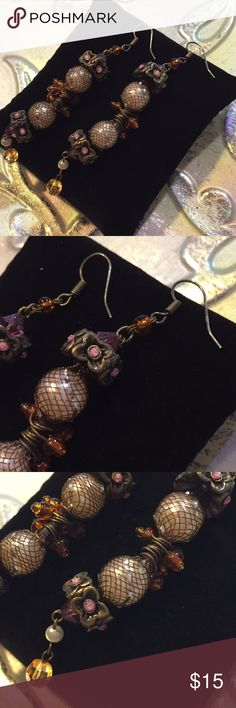 Long Artisan made totally awesome vintage earrings These are heavy and well made. A variety of beads are mixed in this vintage artisan made set   Please  use photos and title as  the main description. Final cleaning to be done by you.  All jewelry is pre-owned and may show appropriate wear for the age of the piece.    Our jewelry comes from estate sales, we have no control over the origin of it.   Please Ask if you have questions, and check out my other listings too as we liquidated our…
