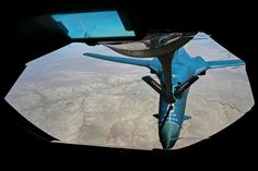 A United States Air Force KC-135 Stratotanker refuels a U.S. Air Force B-1B Lancer over Southwest Asia to support Operation Inherent Resolve. The Stratotanker crew is assigned to the 340th Expeditionary Air Refueling Squadron. The Lancer and its crew are assigned to the 34th Expeditionary Bomb Squadron.  U.S. Air Force photo by Staff Sgt. Sandra Welch