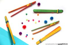 Build fine motor skills including pencil grasp using these homemade DIY tweezers made from craft sticks.