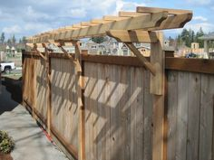 """Arbor"" built into fence for added height privacy (could also hang hanging baskets at posts?  By GARDEN TRELLIS DESIGNS"