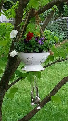 Vintage colander hanging planter with wind chimes
