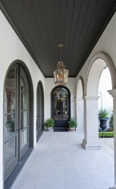 Pillars! Limestone with stucco on top... Fancy entrance. Similar walkway style…